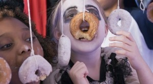 Halloween party games Doughnut bobbing